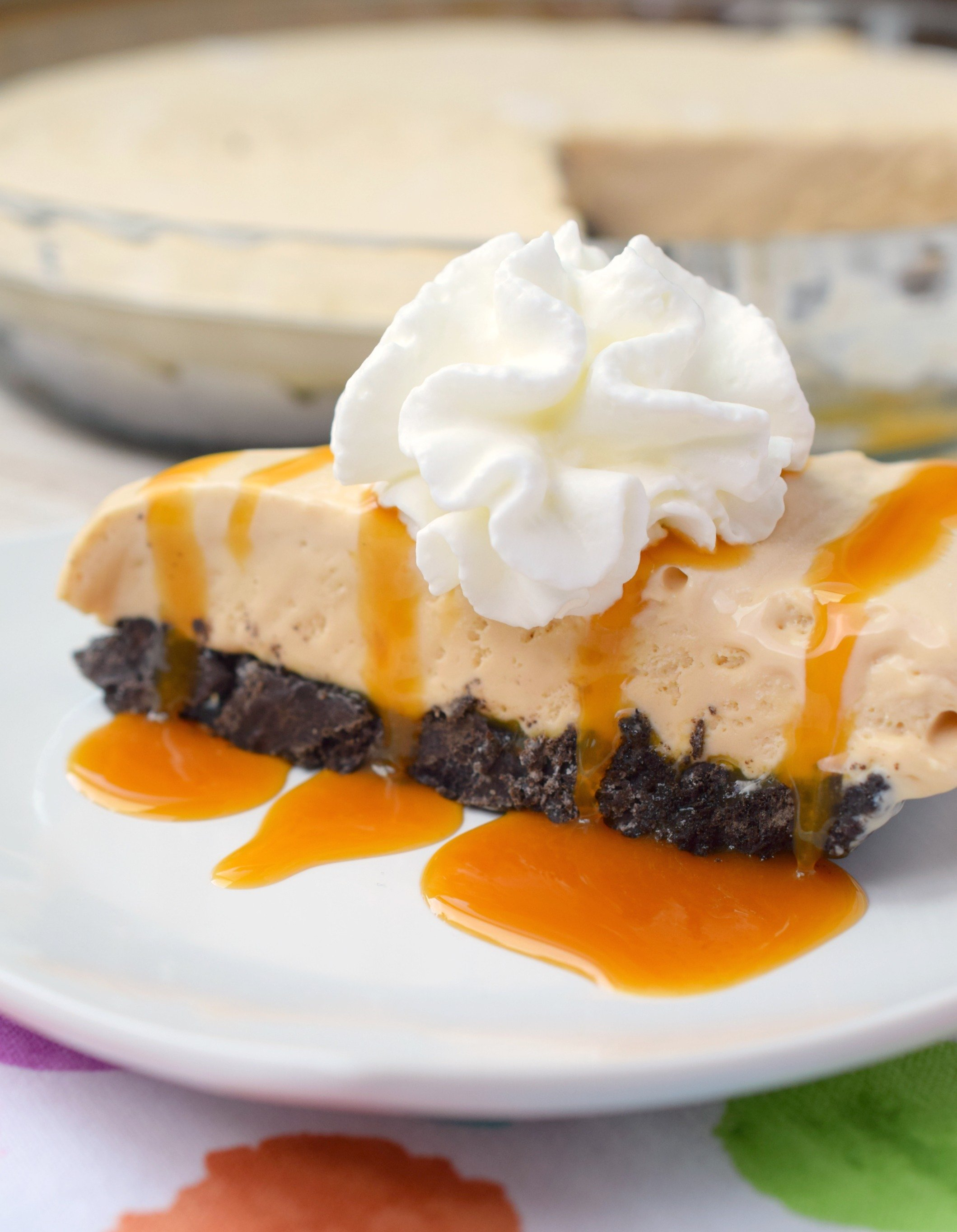 Boozy Dulce de Leche No-Bake Cheesecake combines amazing flavors in one easy to make dessert. Great for parties, you'll love this rich and decadent treat.