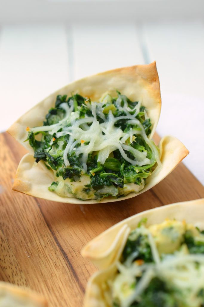 Spinach Artichoke Wonton Cups are party perfect! Bite-sized and easy to prepare, they are loaded with delicious flavors. They are a great holiday appetizer!