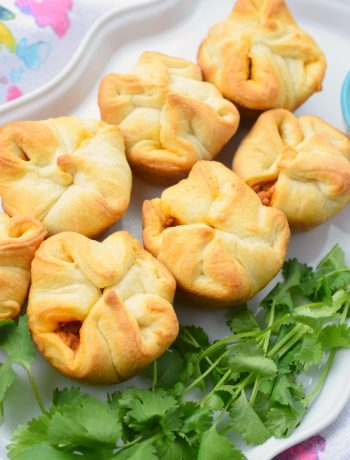 Cheesy Chorizo Bites - A quick and easy appetizer perfect for game day! Crescent dough filled with chorizo, cream cheese, and cheddar cheese.