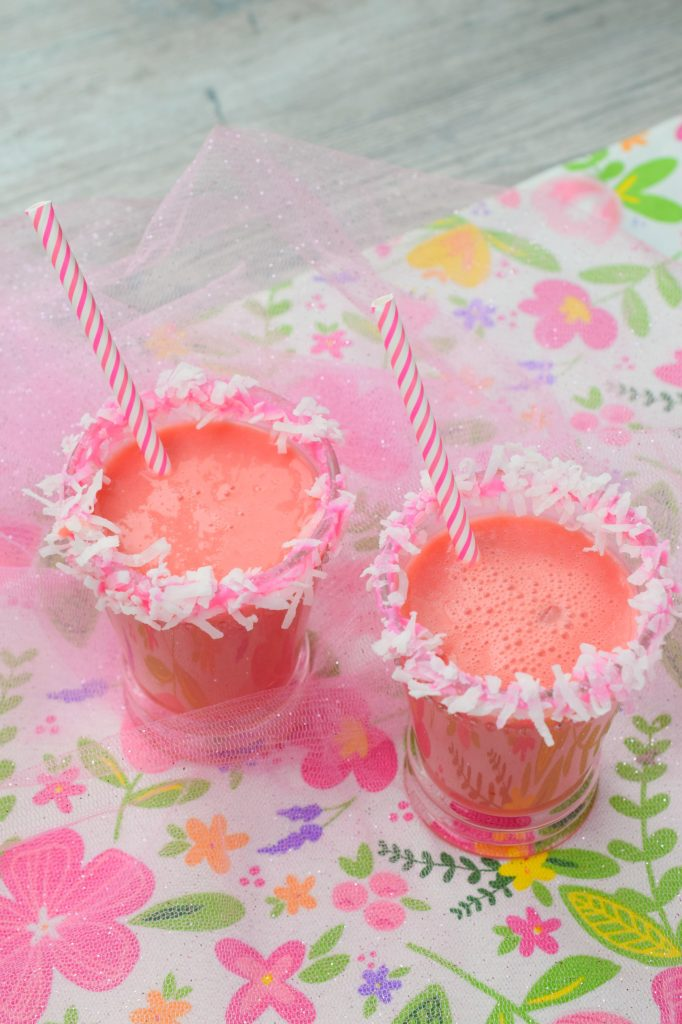 two glasses on floral cloth with straws and decorated edge