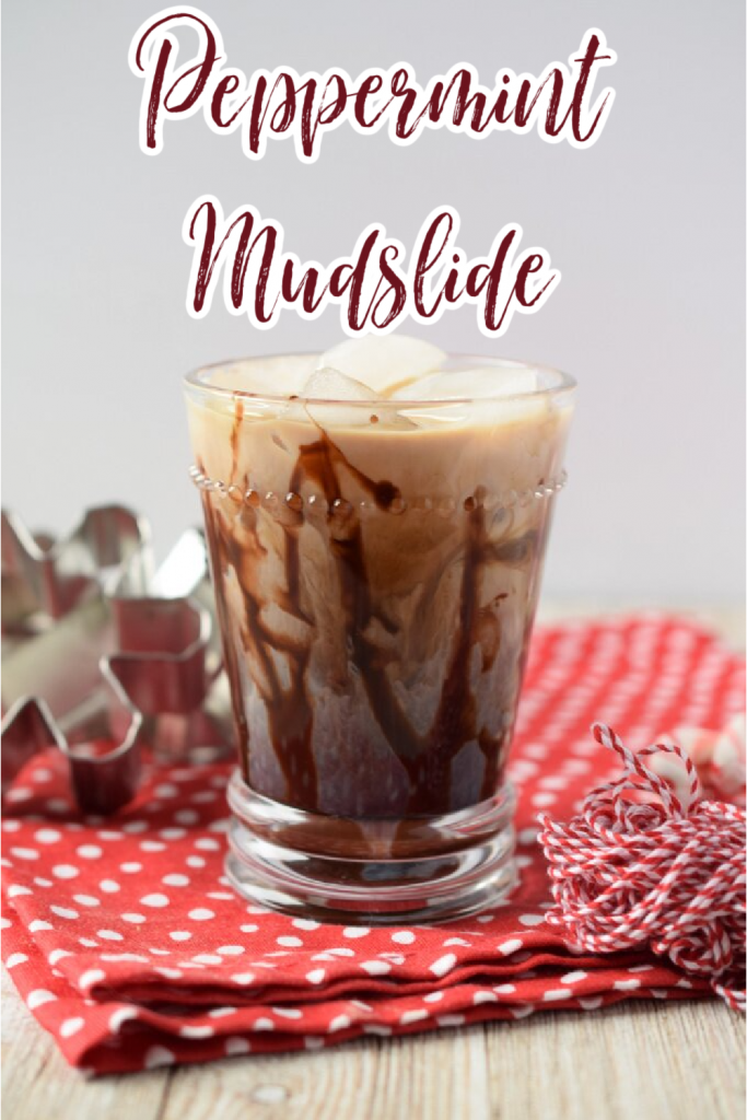 Peppermint Mudslide – A holiday spin on a classic cocktail. Made with Kahlua, Vodka, Bailey's, heavy cream, chocolate syrup, and peppermint simple syrup. This easy cocktail is sure to be a hit. Mudslide Cocktail Recipe | Peppermint Cocktail | Christmas Cocktail Recipe