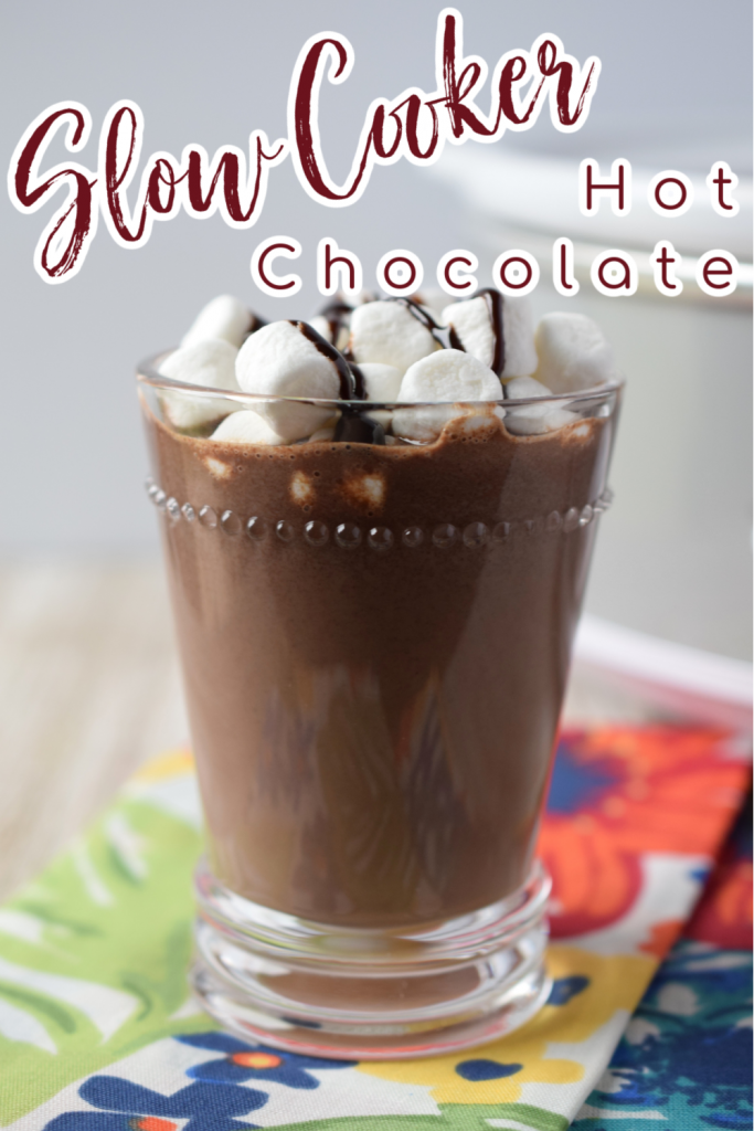 Slow Cooker Hot Chocolate - A great way to make a big batch of hot chocolate for a group! Creamy hot chocolate cooked in a crockpot and topped with mini marshmallows.  Slow Cooker Hot Chocolate | Crockpot Hot Chocolate | Hot Chocolate Recipes