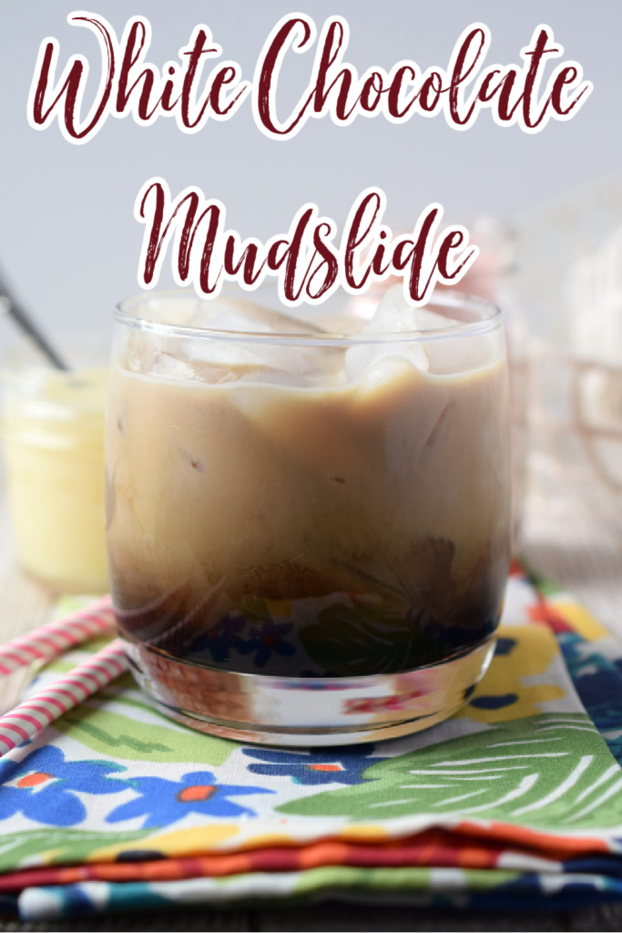 White Chocolate Mudslide – A holiday spin on a classic cocktail. Made with Kahlua, Vodka, Bailey's, heavy cream, and white chocolate syrup. This easy cocktail is sure to be a hit. White Chocolate Mudslide | Mudslide Recipe | Mudslide Cocktail